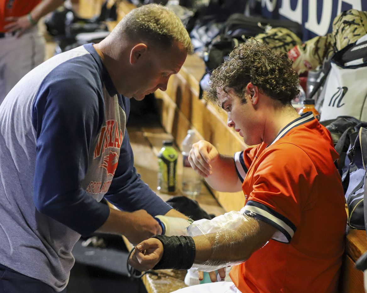 Frisco Wakeland pitcher Robert Fortenberry (9) has ice applied to his arm after exiting the game with an injury during game two of the UIL baseball 5A Region II final series against Hallsville at Horner Ballpark in Dallas on Friday, June 4, 2021. (Elias Valverde II / Special Contributor)
