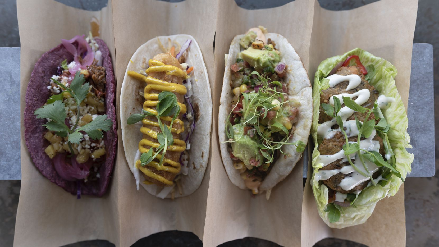 Velvet Tacos' menu items have included (from left) shredded pork; fish n' chips; brisket; and falafel. The menu often changes; these tacos were photographed in August 2018.
