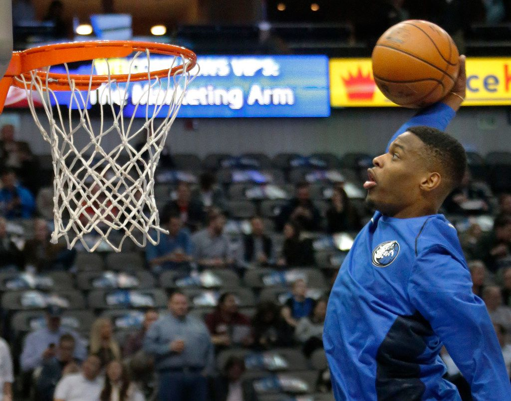 Dallas Mavericks guard Dennis Smith Jr. (1) dunks during warmups before the Houston Rockets vs. the Dallas Mavericks NBA basketball game at the American Airlines Center in Dallas on Wednesday, January 24, 2018. (Louis DeLuca/The Dallas Morning News)