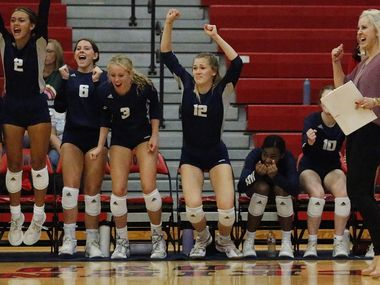 Flower Mound reacts to winning Tuesday's match against McKinney Boyd 18-25, 25-15, 25-20, 25-23. (Stewart F. House/Special Contributor)