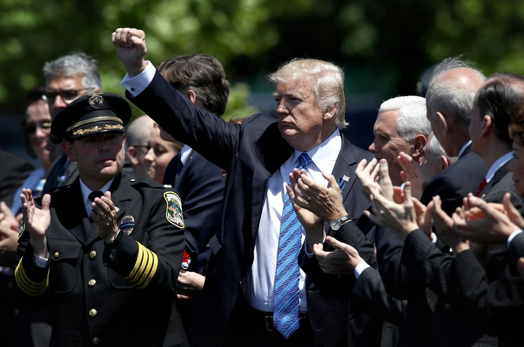 WASHINGTON, DC - MAY 15:  U.S. President Donald Trump concludes his remarks at the 36th annual National Peace Officers' Memorial Service on the west lawn of the U.S. Capitol on May 15, 2017 in Washington, DC. The service is part of National Police Week and honors police officers across the country, and families who lost loved ones in the line of duty. (Photo by Win McNamee/Getty Images)