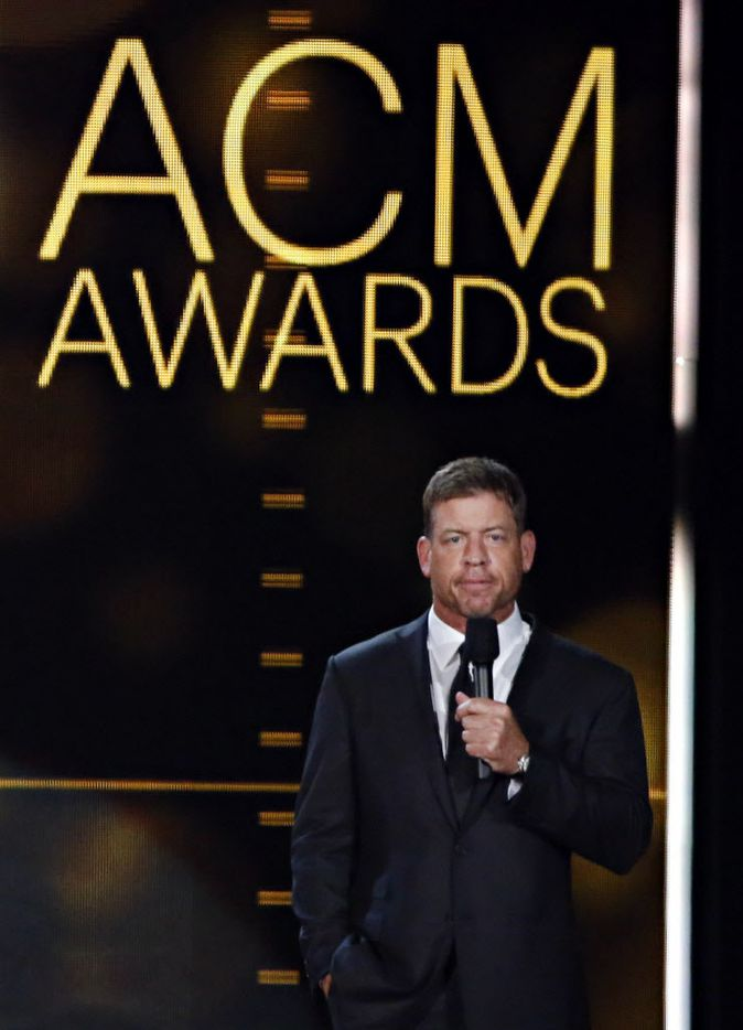 Former Dallas Cowboys quarterback Troy Aikman speaks during the 2015 Academy of Country Music Awards Sunday, April 19, 2015 at AT&T Stadium in Arlington, Texas.