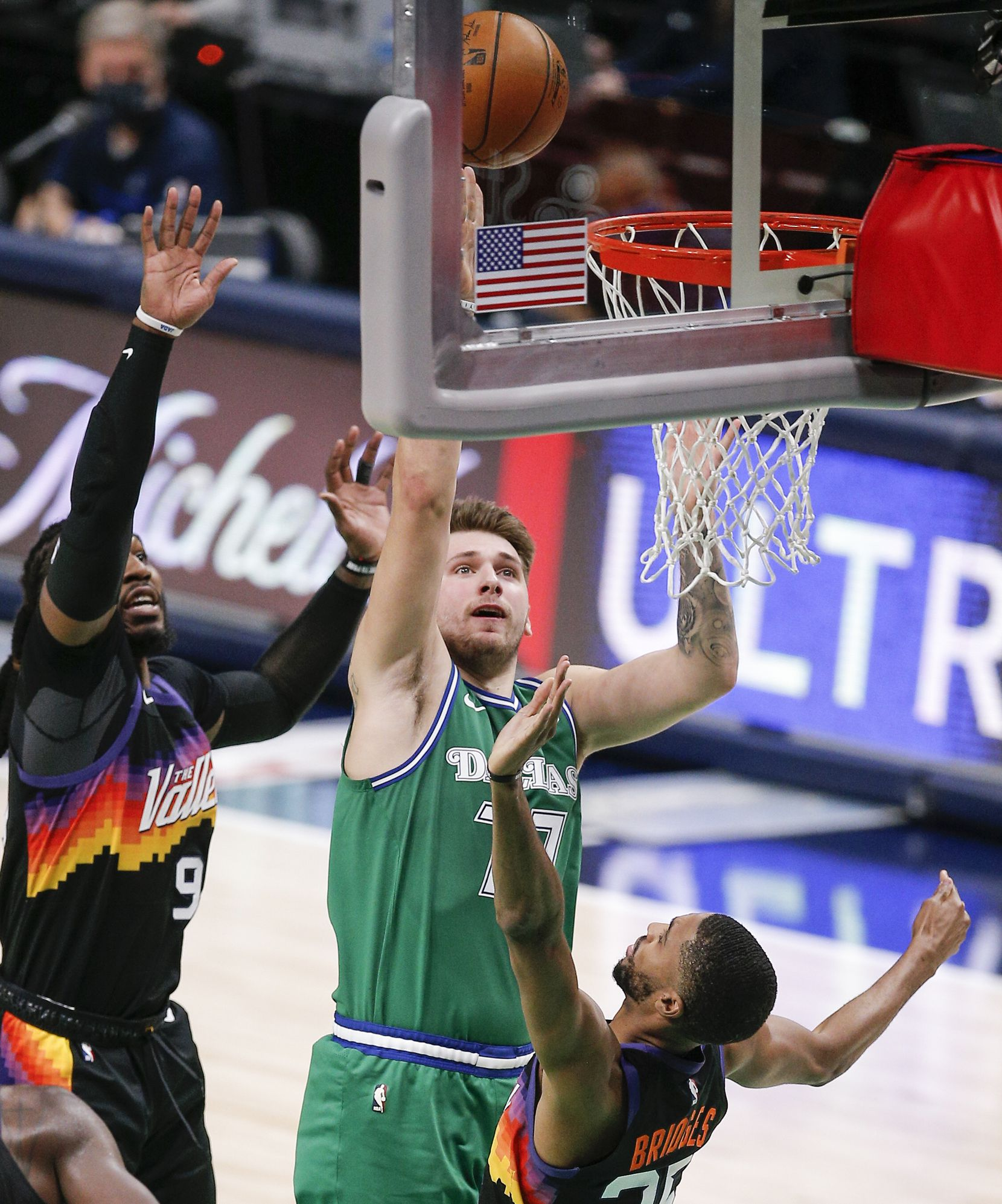Dallas Mavericks guard Luka Doncic (77) attempts a shot as Phoenix Suns forwards Jae Crowder (99) and Mikal Bridges (25) defend during the second half of an NBA basketball game in Dallas, Saturday, January 30, 2021. Phoenix won 111-105. (Brandon Wade/Special Contributor)