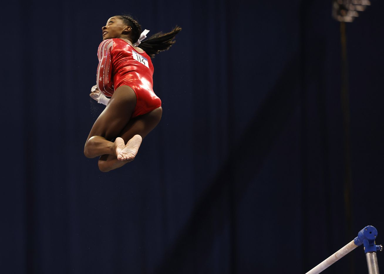 Simone Biles competes on the uneven bars during day 2 of the women's 2021 U.S. Olympic Trials at The Dome at America's Center on Saturday, June 27, 2021 in St Louis, Missouri.(Vernon Bryant/The Dallas Morning News)