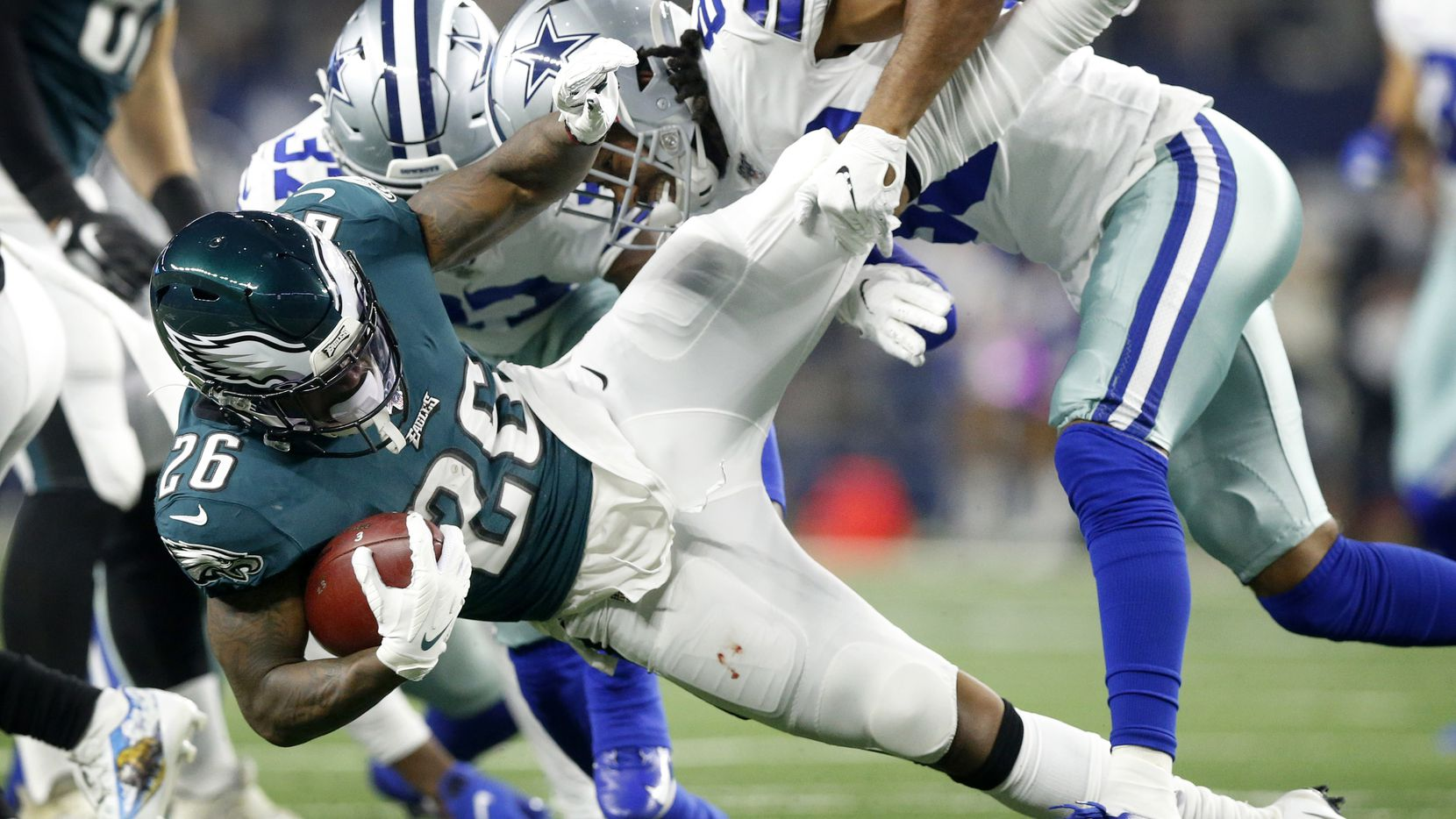 Dallas Cowboys wide receiver Ventell Bryant (83) and defensive back Donovan Wilson (37) drop Philadelphia Eagles kick returner Miles Sanders (26) during the first quarter at AT&T Stadium in Arlington, Texas, Sunday, October 20, 2019. (Tom Fox/The Dallas Morning News)