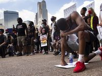 "Ryan Hunter of Fort Worth kneels at Dallas City Hall after peacefully marching through downtown Dallas demonstrating against police brutality on June 2, 2020. ""I'm tired of seeing people that look like me dead in the streets,"" Hunter said."
