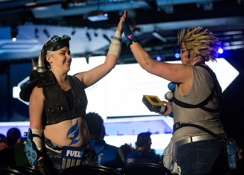 Sisters Kas and Kat Bradley from Dallas wear costumes inspired by the The Dallas Fuel during the season three opening weekend match of the Overwatch League against the San Francisco Shock on Feb. 9, 2020 at the Esports Stadium in Arlington. The Fuel lost 3-1. (Juan Figueroa/ The Dallas Morning News)