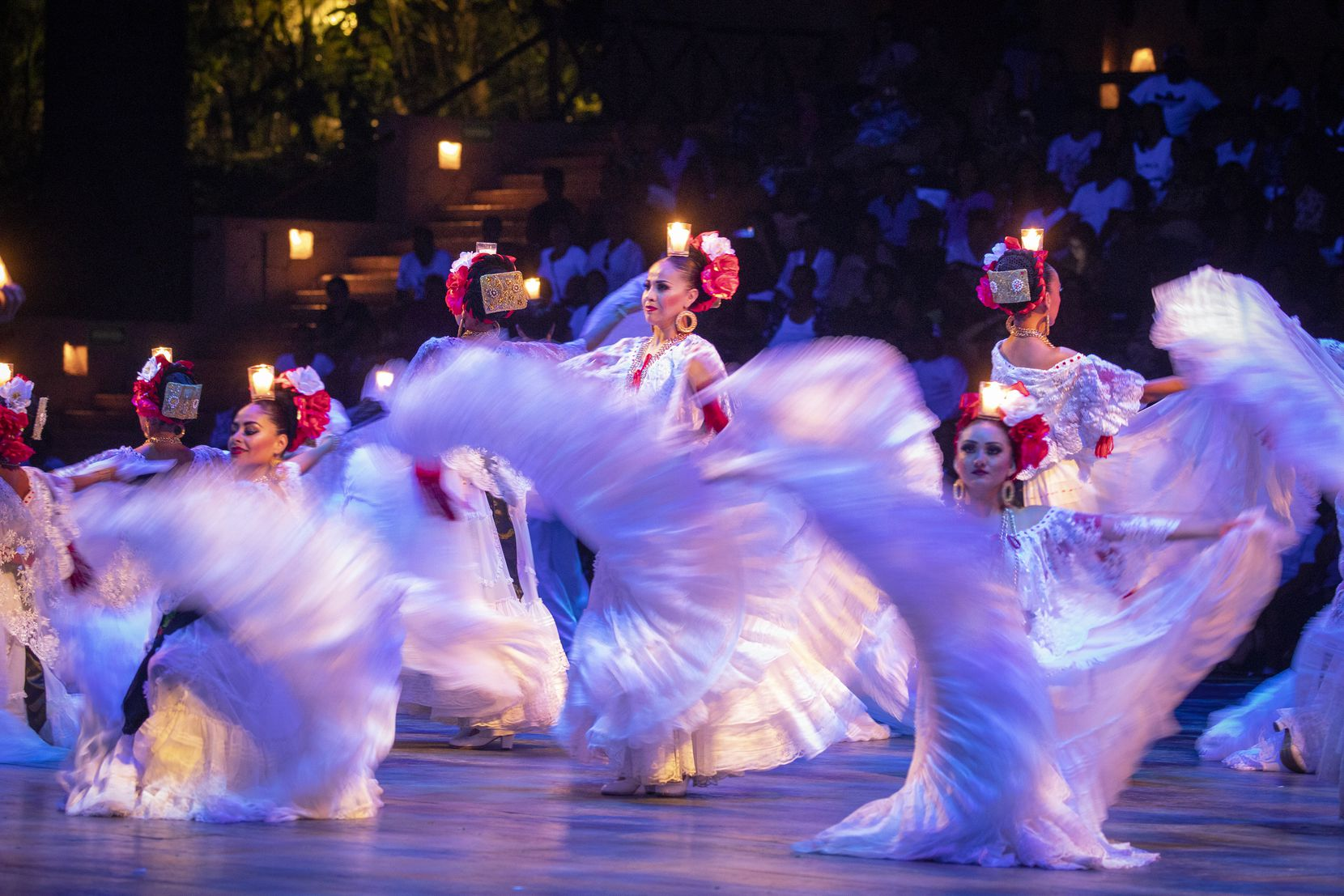Dancers perform during a show documenting the history of Mexico at Xcaret Park.