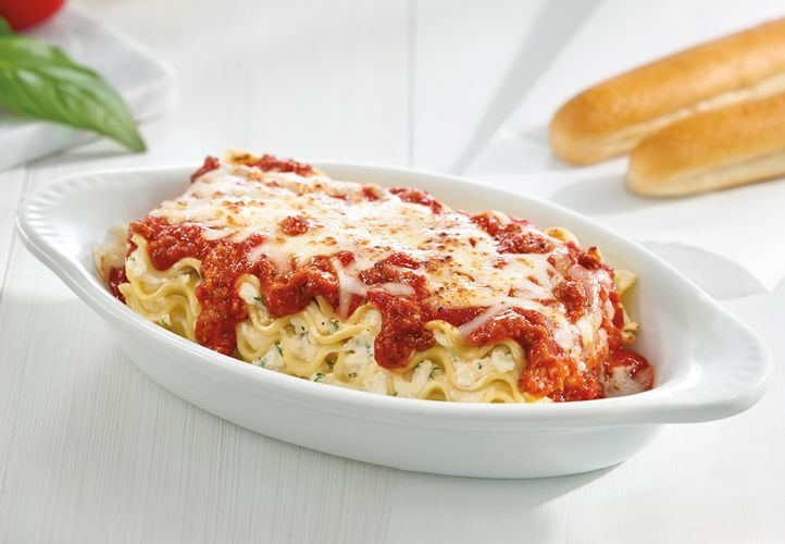 Fazoli's entrees such as lasagna are served with two hot breadsticks.
