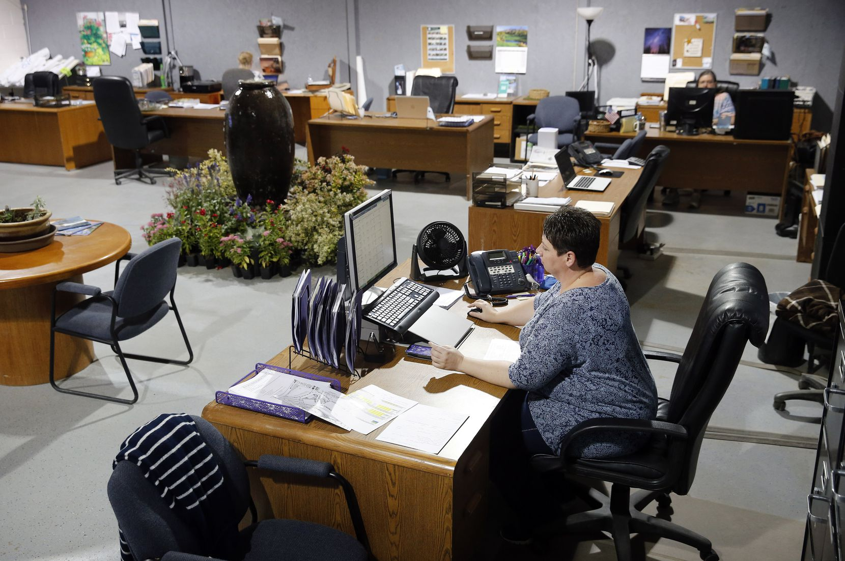 Work spaces at Highland Landscaping in Southlake have been spaced out so employees can maintain proper social distancing. Workers don't have to wear masks at their desks, but they must do so if they move around the office.