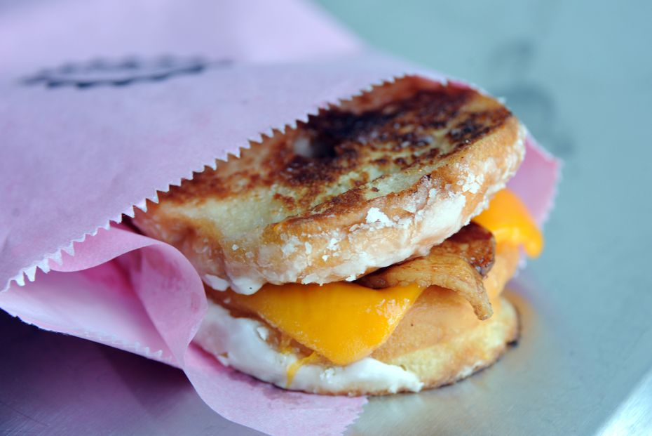The Donut Grilled Cheese from Glazed Donut Works has mild cheddar with thick applewood smoked bacon sandwiched between a butter-griddled glazed donut. No telling if it'll be involved in Glazed's popups, but it was often featured on the shop's late-night menu in Deep Ellum.