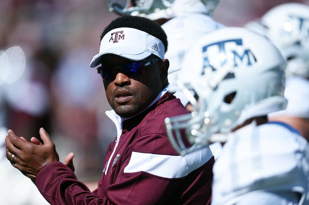 STARKVILLE, MS - OCTOBER 04:  Head coach Kevin Sumlin of the Texas A&M Aggies leads his team onto the field prior to a game against the Mississippi State Bulldogs at Davis Wade Stadium on October 4, 2014 in Starkville, Mississippi.  (Photo by Stacy Revere/Getty Images)