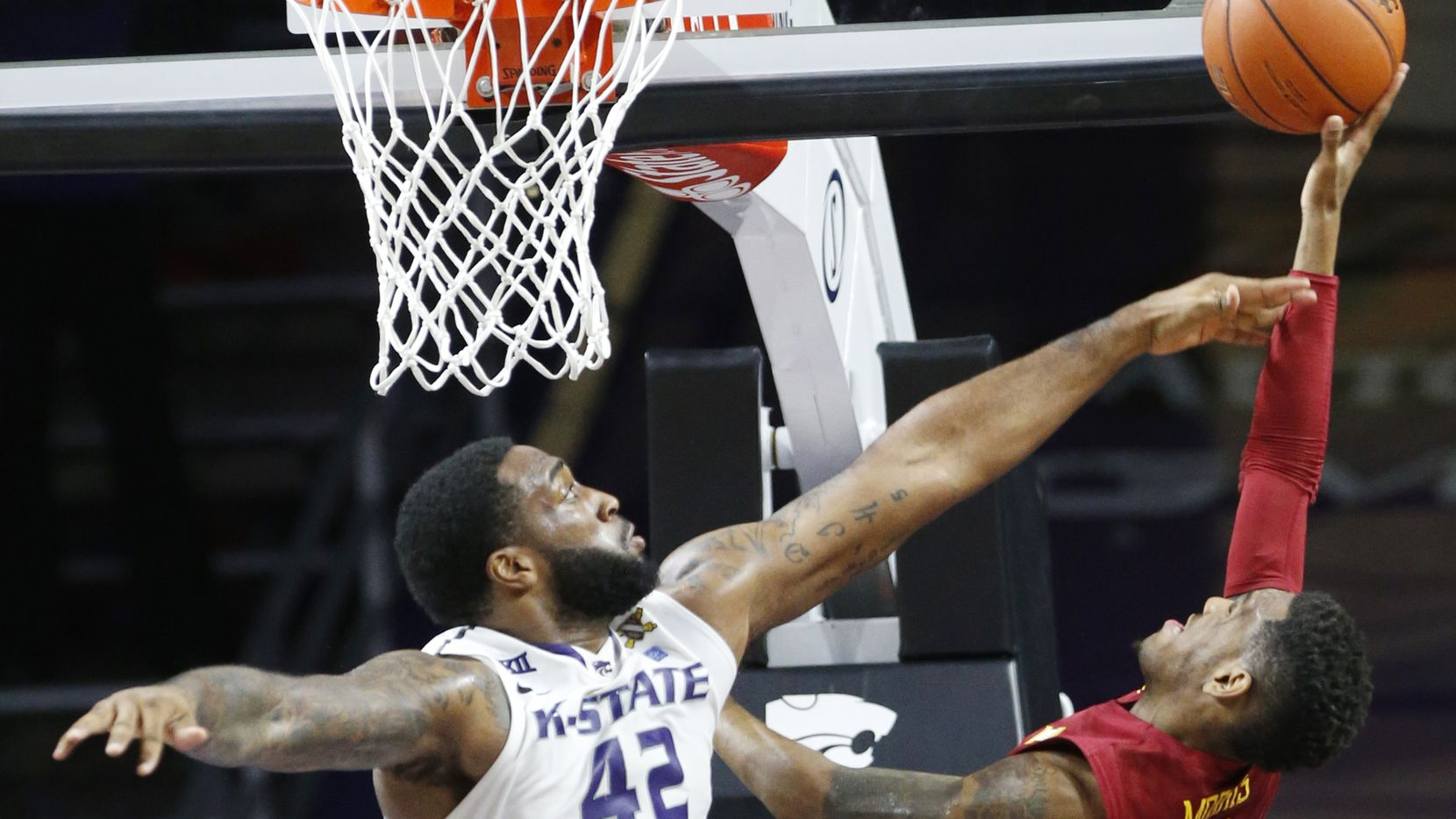 Kansas State forward Thomas Gipson (42) attempts to knock down a shot by Iowa State guard Monte Morris (11) fouling him in the process in their NCAA college basketball game in Manhattan, Kan. on Saturday, Feb. 28, 2015 as the Wildcats took on #12 Iowa State. Morris' shot tied the game with seconds left to go. (AP Photo/The Wichita Eagle, Bo Rader)