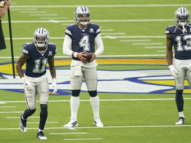 Cowboys wide receiver Cedrick Wilson (11), quarterback Dak Prescott (4) and wide receiver Michael Gallup (13) warm up before a game against the Los Angeles Rams on Sunday, Sept. 13, 2020, in Inglewood, Calif.