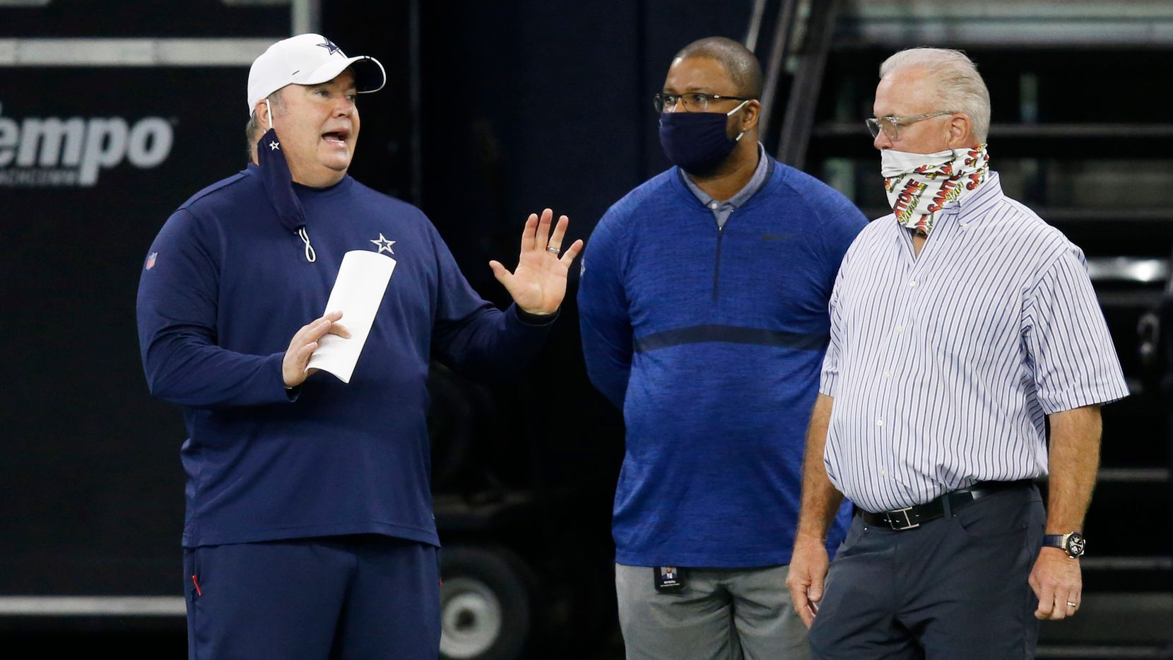 Cowboys head coach Mike McCarthy talks with vice president of player personnel Will McClay and executive vice president Stephen Jones during training camp at The Star in Frisco on Friday, Aug. 28, 2020.