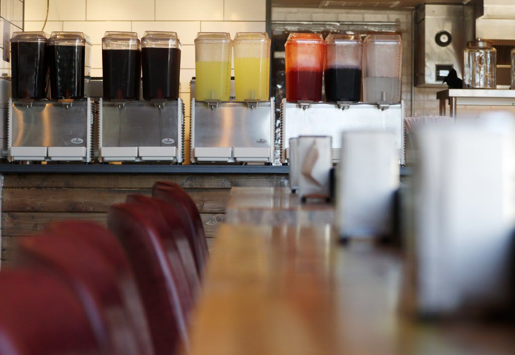 Fruit drinks line the bar of Off-Site Kitchen's new Trinity Groves location in Dallas.
