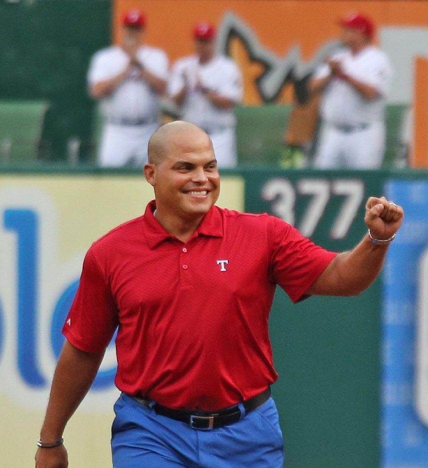 "Ivan ""Pudge"" Rodriguez is all smiles as he emerges from the Rangers bullpen during ceremonies honoring the former Texas catcher before the Houston Astros vs. the Texas Rangers major league baseball game at Globe Life Park in Arlington, Texas on Saturday, August 12, 2017."