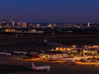 A nighttime view of Austin-Bergstrom International Airport with the city of Austin in the distance.Image downloaded from the airport's media images site.