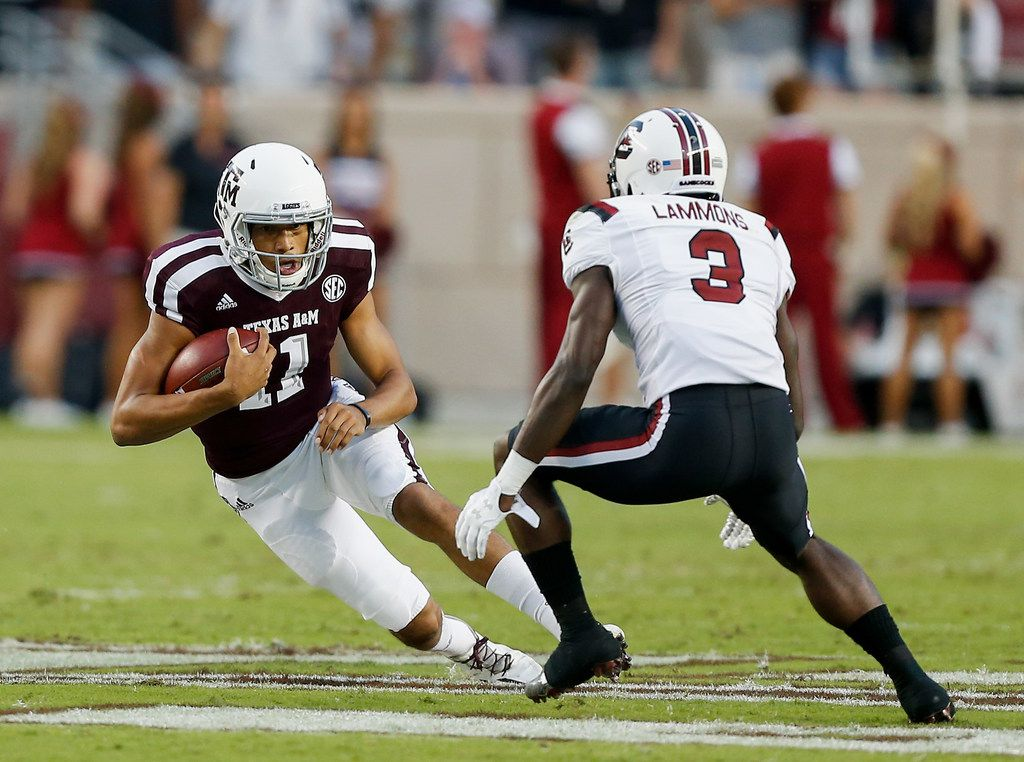 COLLEGE STATION, TX - SEPTEMBER 30:  Kellen Mond #11 of the Texas A&M Aggies attempts to get around Chris Lammons #3 of the South Carolina Gamecocks in the first half at Kyle Field on September 30, 2017 in College Station, Texas.  (Photo by Bob Levey/Getty Images)