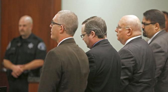 Eric Williams, with attorneys Matthew Seymour (left), John Wright (second from right) and Maxwell Peck, listens as his sentence is read.