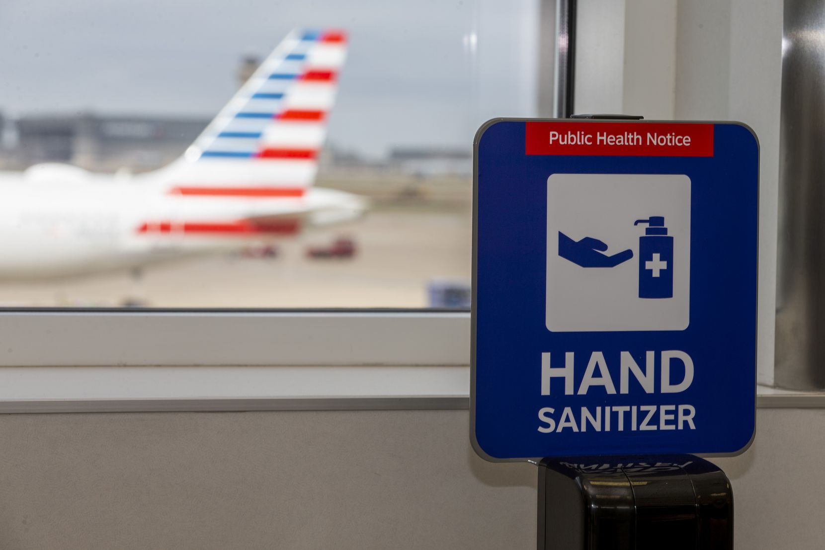 A hand sanitizing station is available to passengers at DFW Airport's Terminal D.