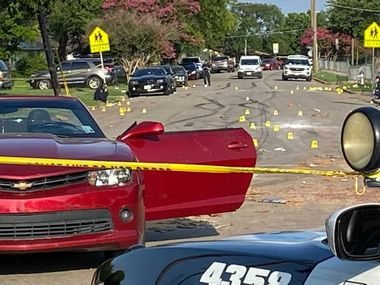 Dallas police investigate the aftermath Monday of a Fourth of July shooting in Lake Highlands.