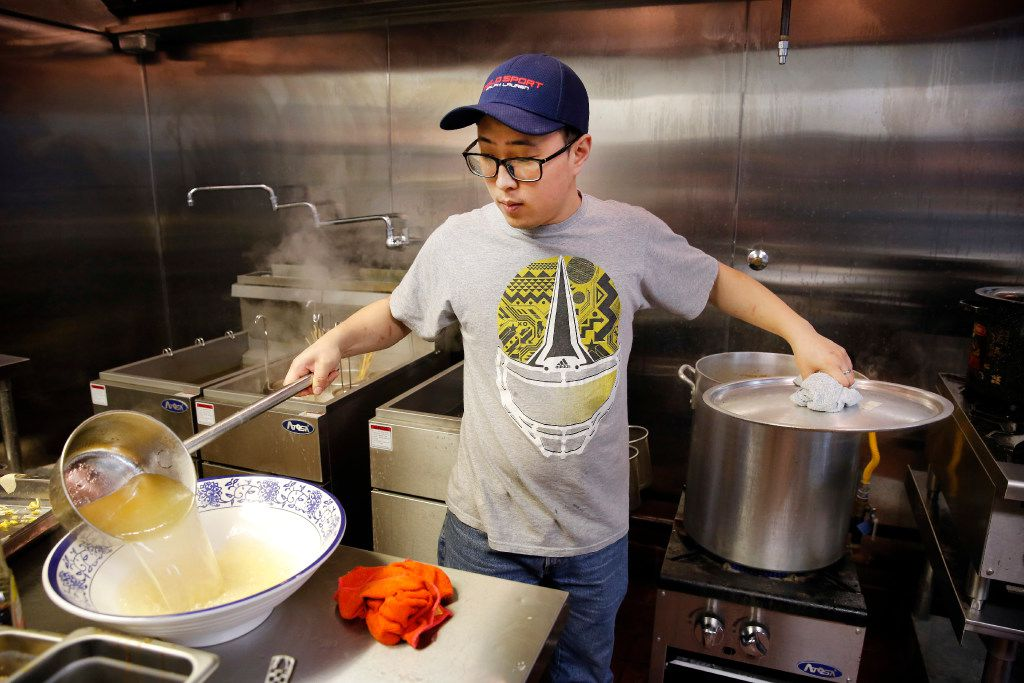 Chef-owner Charles Jiang prepares skewers and broth at Chuan Chuan Boiled Skewer Restaurant. (Tom Fox/Staff Photographer)