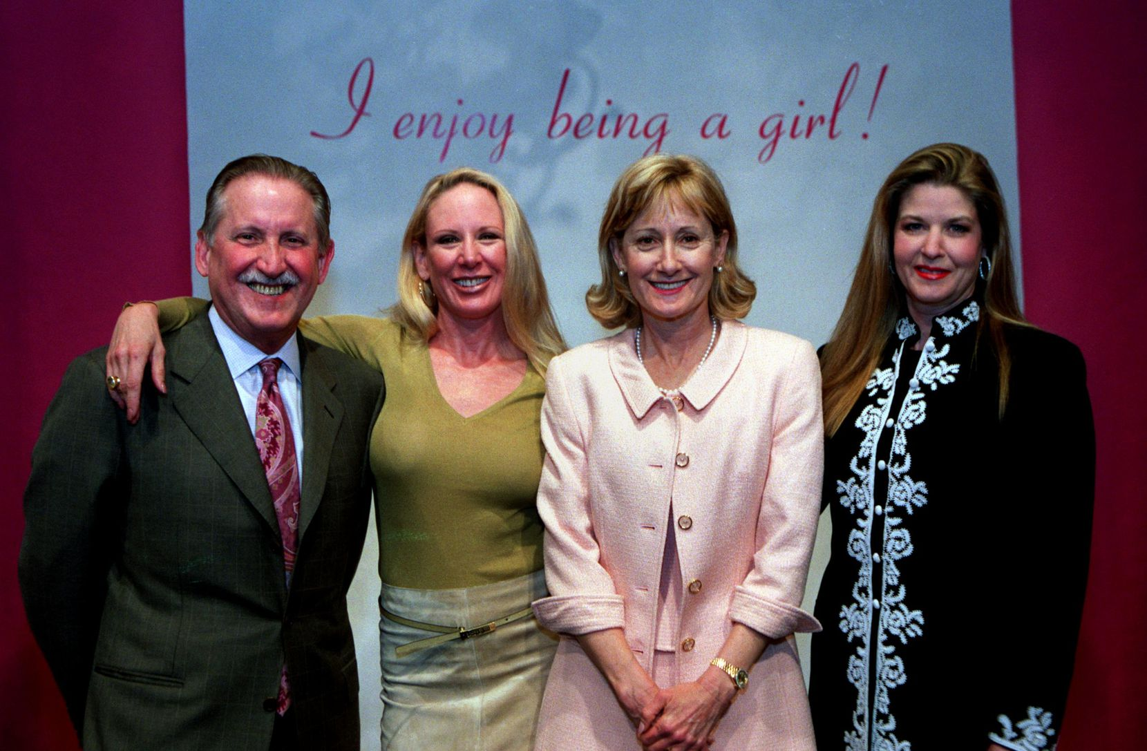 In this May 7, 2002 photo, Nancy Elizabeth Underwood, in pink, was among those attending the Salvation Army Women's Auxiliary Fashion Show and Luncheon at the Dallas Country Club. Also in the photo (from left) were Jim Farr, Heidi Dillon and Tammy Scarborough.