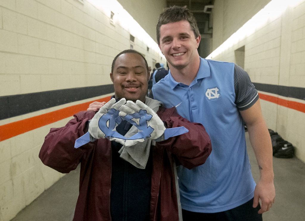 Ryan Switzer, right, poses with Clifton Reid, left, after a UNC game in 2016. They have been friends 12 years. (photo by Michael Switzer)
