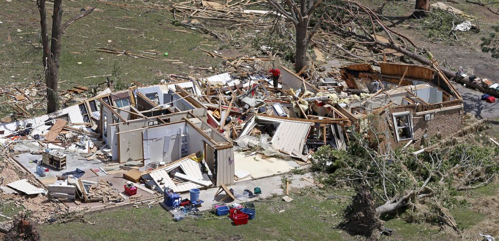 A man salvages belongs inside a destroyed house in Canton, Sunday, April 30, 2017. Severe storms including tornadoes swept through several small towns killed at least four people in East Texas on April 29, 2017.