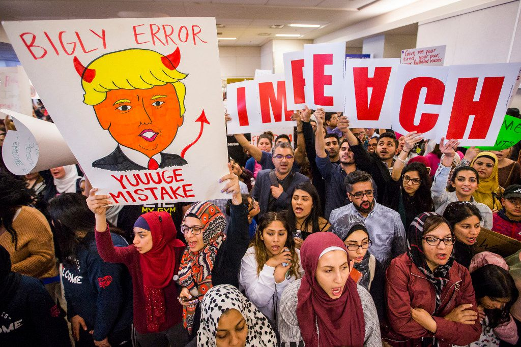 Protesters gathered over the weekend at DFW International Airport to protest the president's executive order. (Smiley N. Pool/Staff Photographer)