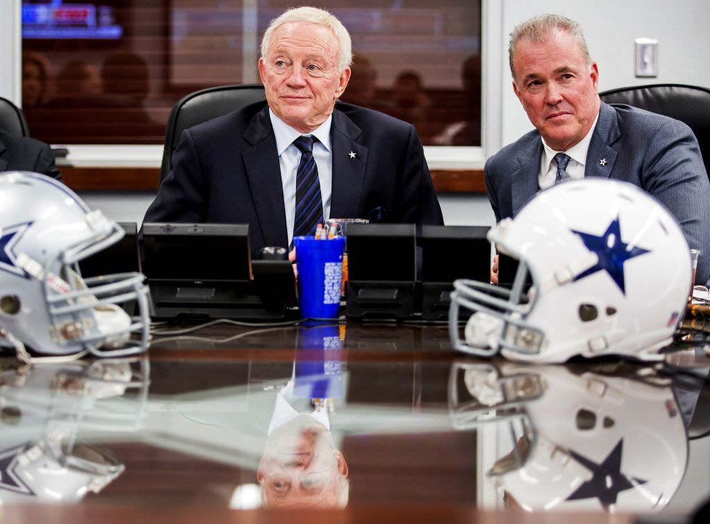 FILE - Cowboys owner Jerry Jones (left) and executive vice president Stephen Jones watch earlier picks in the 2015 NFL draft from the team's war room at Valley Ranch in Irving on April 30, 2015.