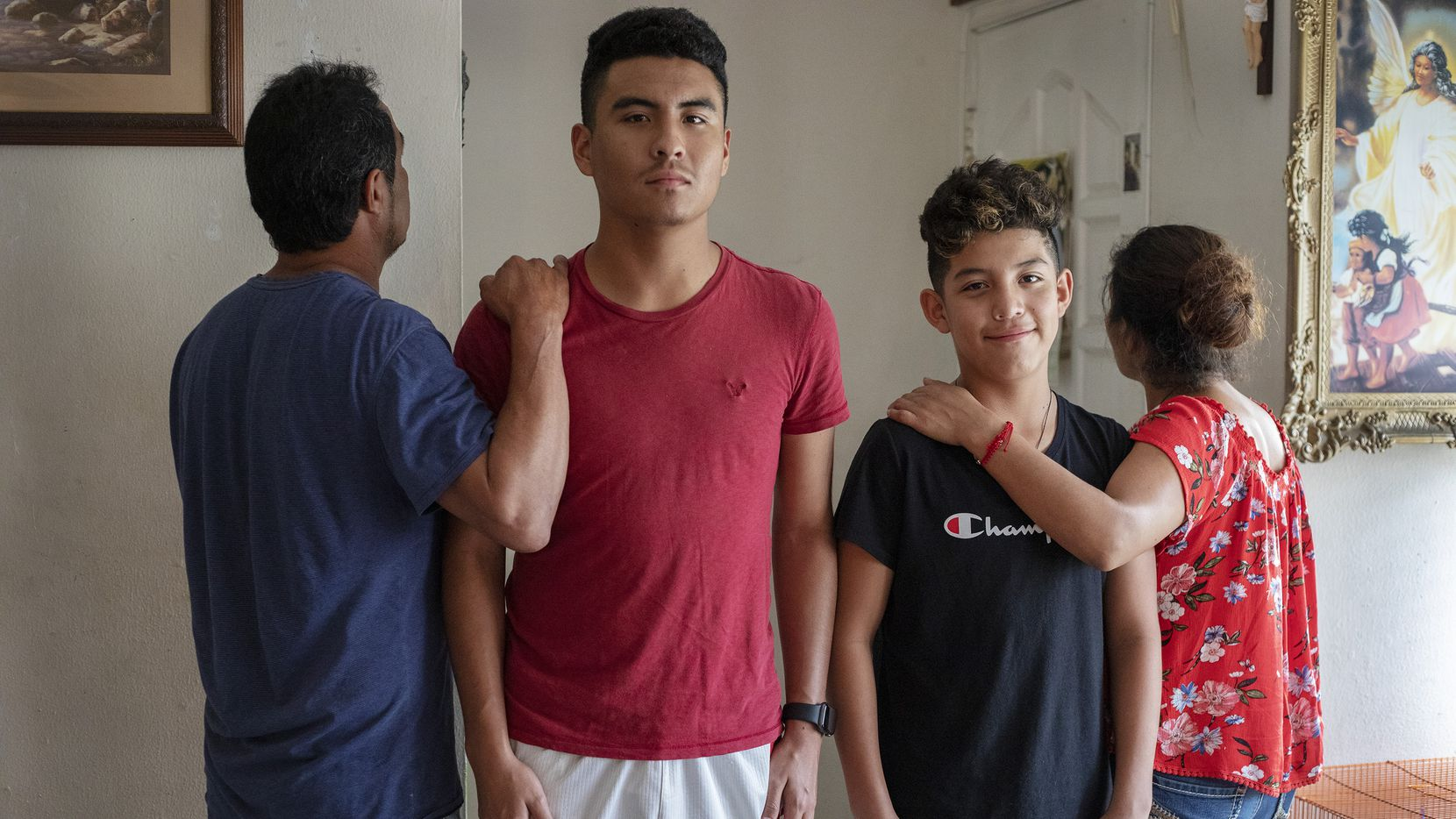 Marco and Max Jr. Trejo (center left-right) with their parents Max and Jacobo Trejo at their home in Irving on Aug. 30.  ICE knocked on the door to the family home but they didn't answer.  Soon after Max Trejo was detained by ICE in the neighborhood and later released. Max Jr. suffered symptoms of stress according to family's doctor, and Marco cried at night during his father's detention. The family is awaiting a court hearing to determine if Max Sr. will be deported.