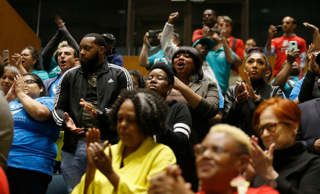 People celebrate after seeing the vote for earned paid sick time leave passed during a city council meeting at Dallas City Hall in Dallas on Wednesday, April 24, 2019. he city council voted Wednesday to mandate Dallas businesses within the city limits to provide earned paid sick time to employees. (Vernon Bryant/The Dallas Morning News)