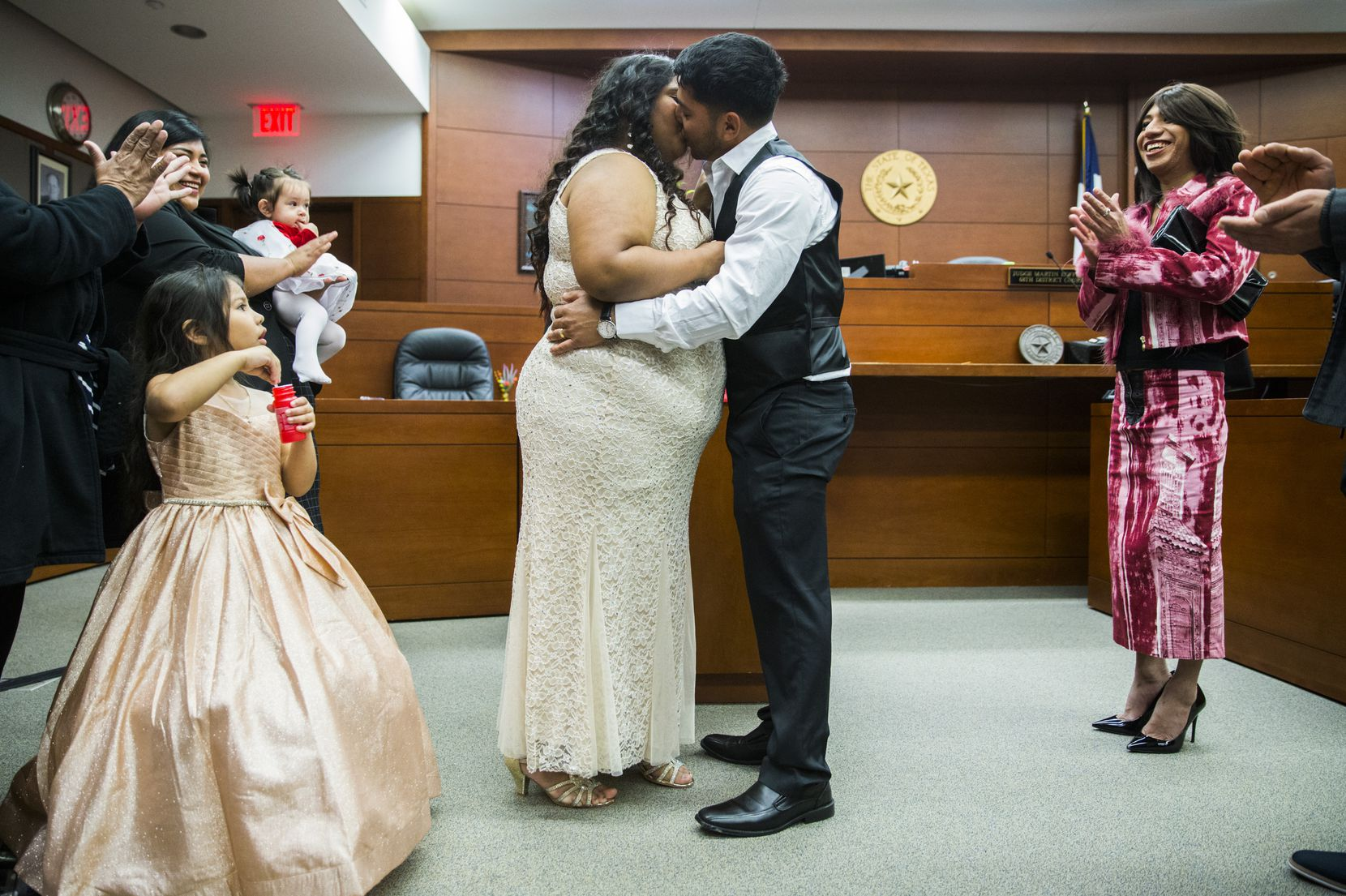 Anna Zapata and Walter Rivera kissed as they were married by Judge Martin Hoffman on Valentine's Day.