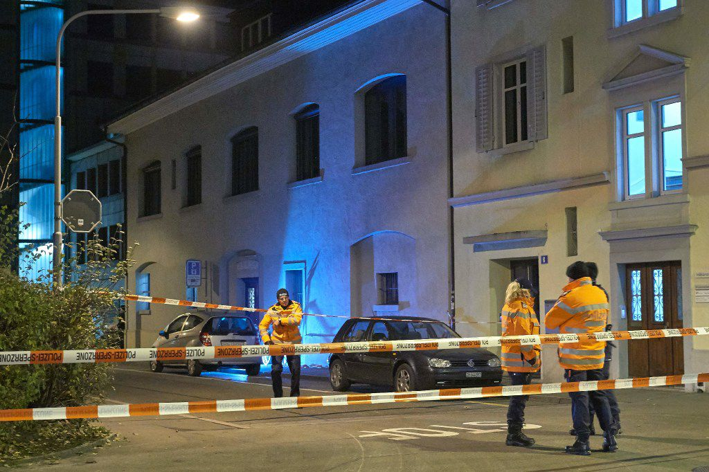 Swiss police are seen outside a Muslim prayer hall, central Zurich, on December 19, 2016, after three people were injured by gunfire.