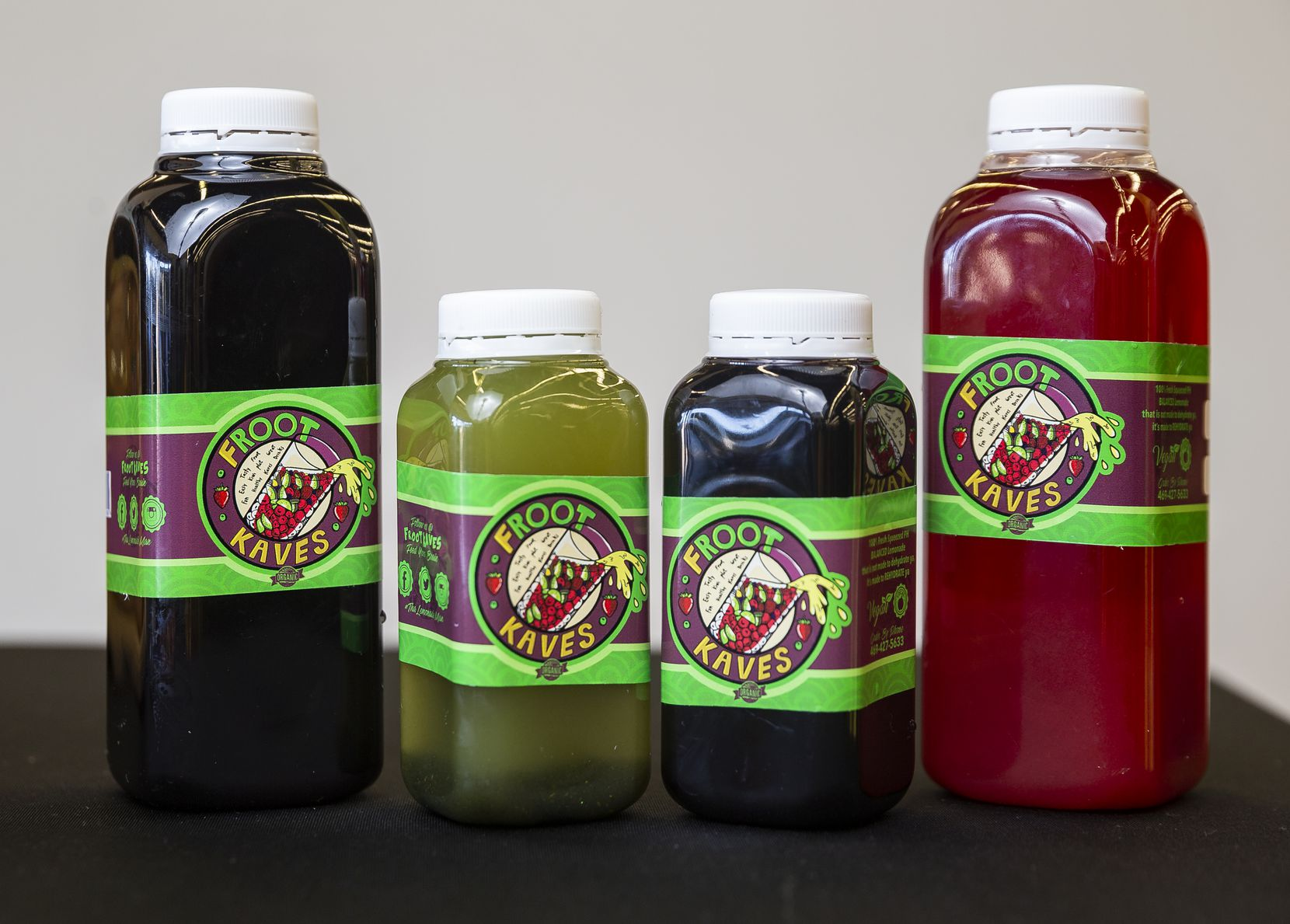 Bottles of the Froot Kaves powerberry syrup, Black lemonade and cherry limeade at their stand in the Grow DeSoto Market Place