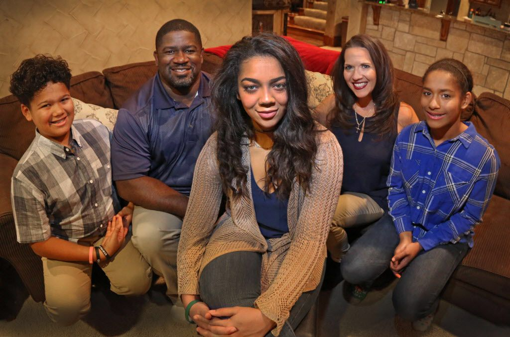 Dallas Cowboys running backs coach Gary Brown is pictured with his daughter Malena, center, along with the rest of his family: wife Kim,  daughter Dorianna, right, and son Tre, left, at their home in Keller on Friday, November 18, 2016. (Louis DeLuca/The Dallas Morning News)