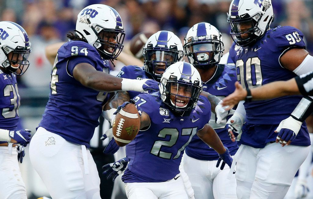 FILE - TCU safety Ar'Darius Washington (27) celebrates his first-quarter interception against Arkansas-Pine Bluff at Amon G. Carter Stadium in Fort Worth on Saturday, Aug. 31, 2019.