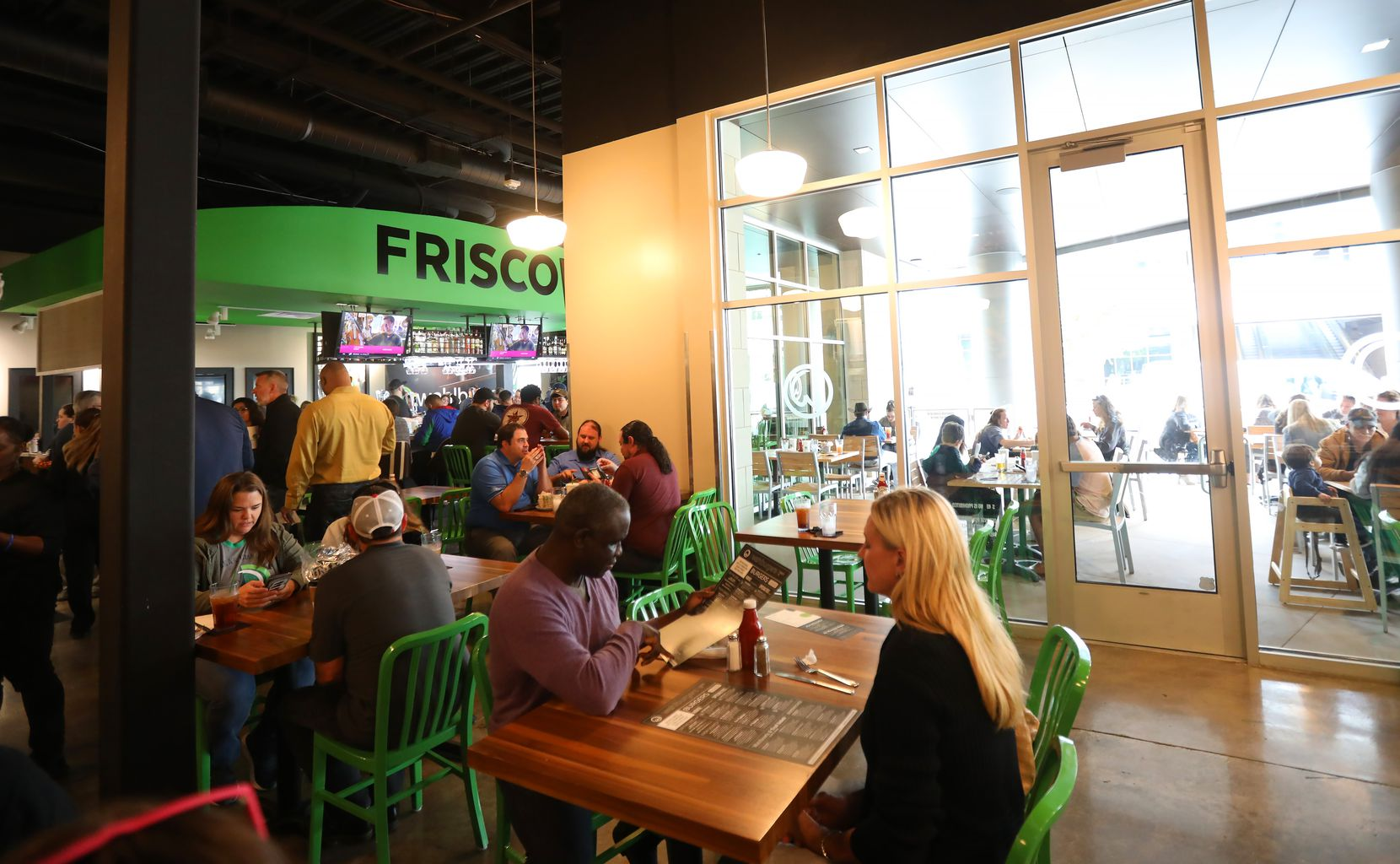 Though Wahlburgers is a casual restaurant, it's not fast-casual. Customers are seated by a host and waited upon by a server. Customers can sit at the bar, on the patio or in the main dining room.