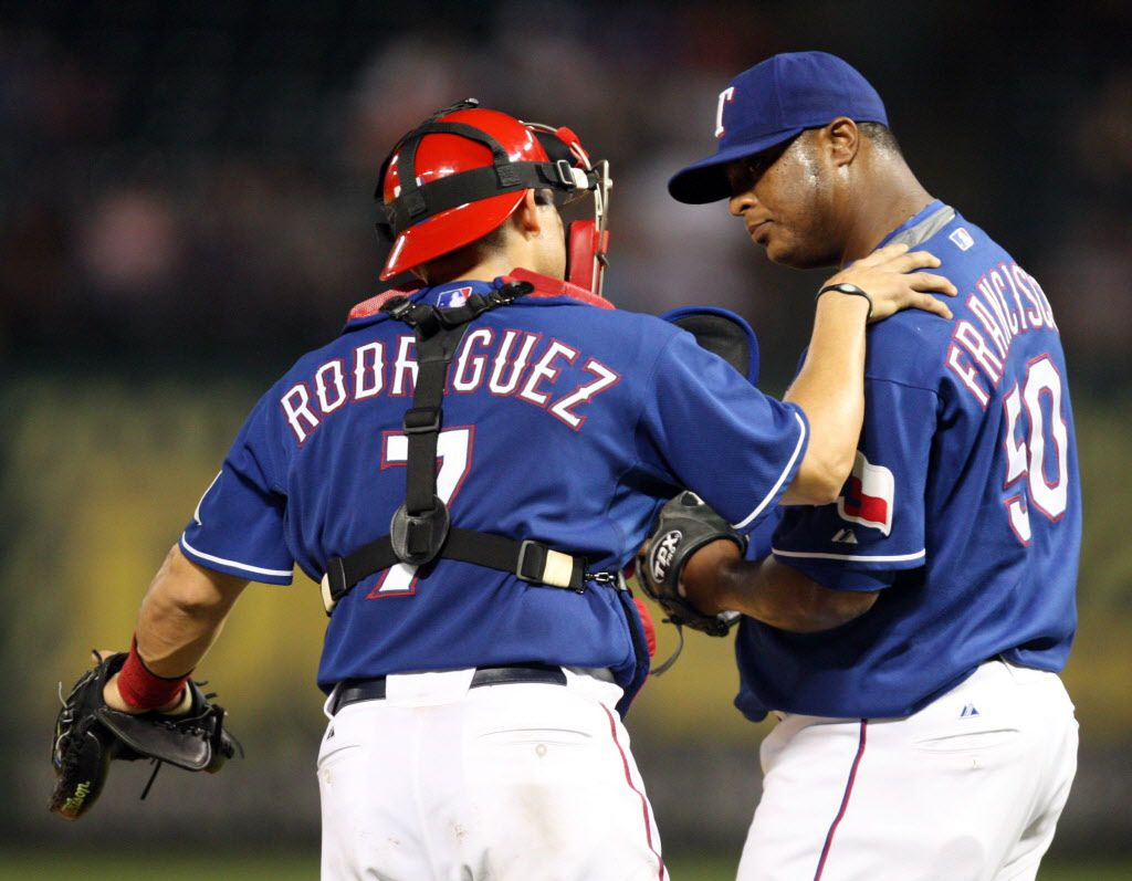 Texas Rangers' Ivan Rodriguez (7) talks with Fank Francisco (50) in a game against the Oakland A's during the top of the ninth inning at the Rangers Ballpark in Arlington on Tuesday, September 15, 2009. The A's defeated the Rangers 6-1. (Vernon Bryant/The Dallas Morning News)