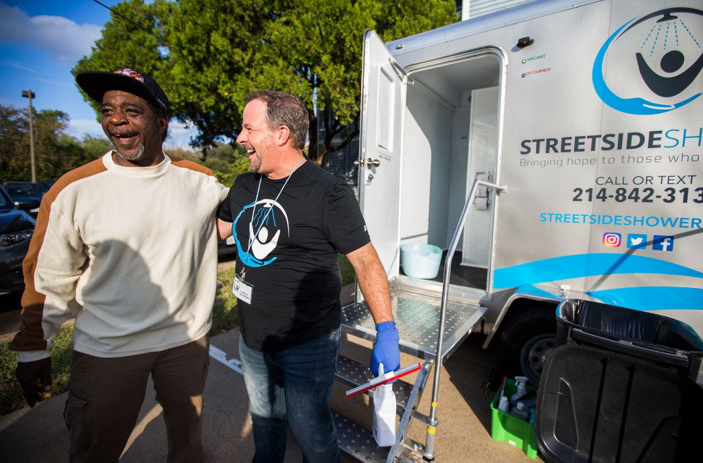 Lance Olinski (right) of Streetside Showers, a program serving the homeless, shared a laugh with Stanford Robinson after Robinson showered in one of Olinski's mobile shower units outside Plano's CityHouse in 2017. CityHouse is one of the agencies selected for a new leadership program from the Communities Foundation of Texas and United Way of Metropolitan Dallas.