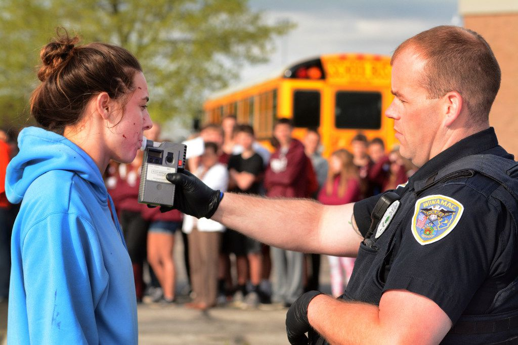 Winamac, Ind., police Officer Aaron Spanley administers a field sobriety test to Isabelle Dotlich, who is portraying a drunken driver in a Winamac High event that simulated a two-car fatal accident. (J. Kyle Keener/Logansport Pharos-Tribune)