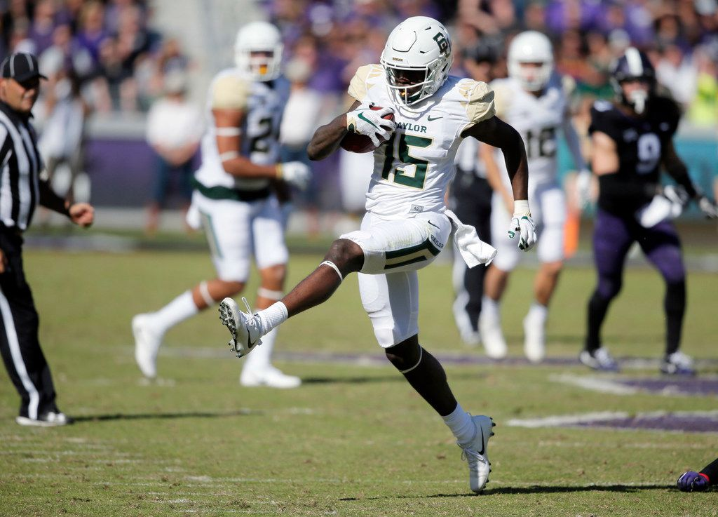 Baylor wide receiver Denzel Mims (15) looks for room against the TCU defense during the first half of an NCAA college football game, Friday, Nov. 24, 2017, in Fort Worth, Texas. TCU won 45-22. (AP Photo/Brandon Wade) ORG XMIT: OTK107