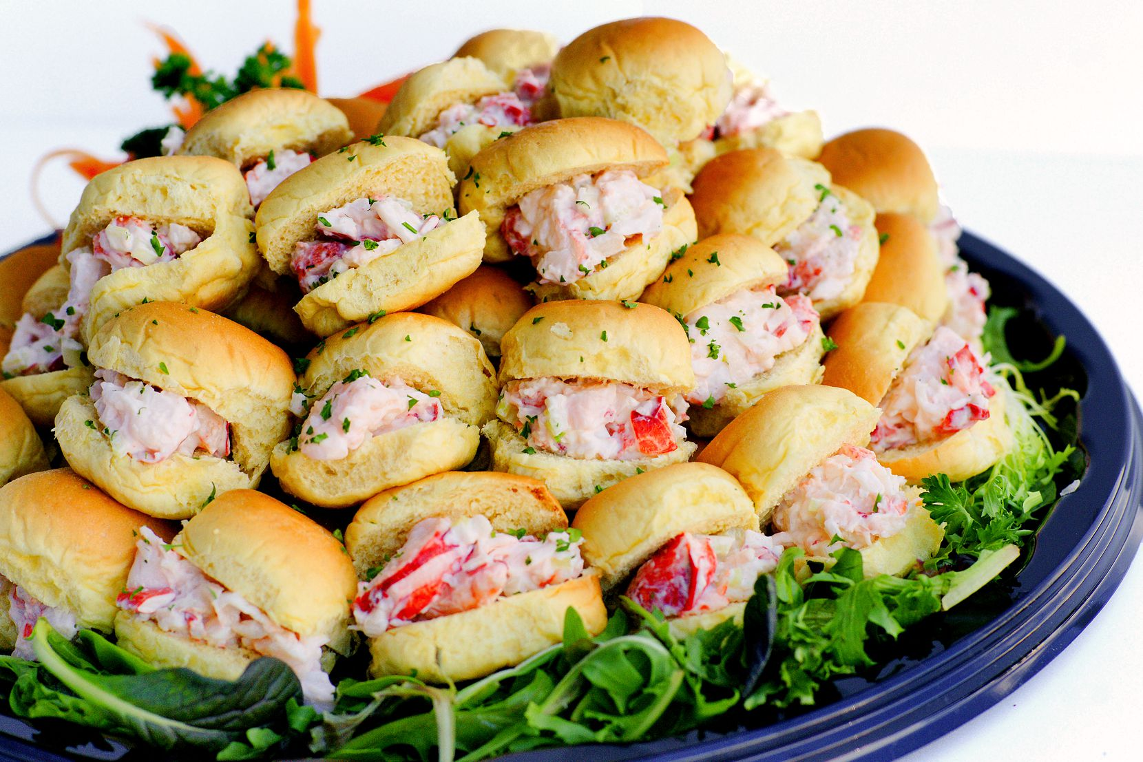 TJ's Seafood Market's Thanksgiving 2020 menu includes platters of lobster roll sliders.