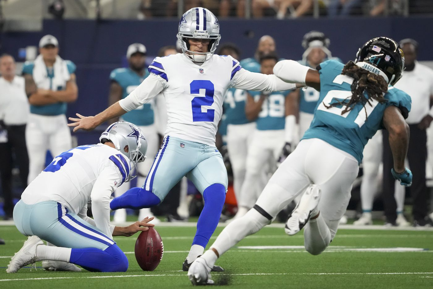 Dallas Cowboys kicker Greg Zuerlein (2) attempts a 56-yard field goal during the first half of a preseason NFL football game against the Jacksonville Jaguars at AT&T Stadium on Sunday, Aug. 29, 2021, in Arlington. (Smiley N. Pool/The Dallas Morning News)