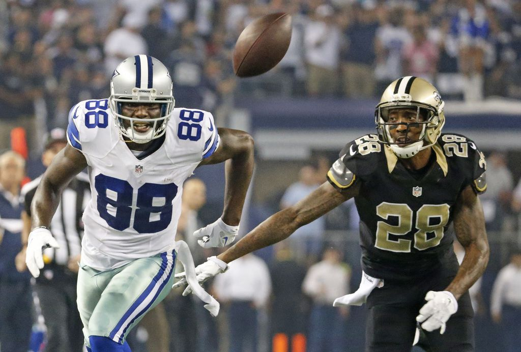 Dallas Cowboys wide receiver Dez Bryant (88) can't get to a second-quarter pass as New Orleans Saints cornerback Keenan Lewis (28) defends during the New Orleans Saints vs. the Dallas Cowboys NFL football game at AT&T Stadium in Arlington on Sunday, September 28, 2014.  (Louis DeLuca/The Dallas Morning News)