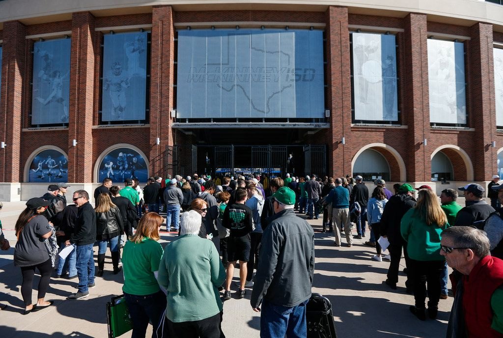 Southlake Carroll fans line up to enter the stadium prior to  a Class 6A Division I Region I high school football matchup between Southlake Carroll and Duncanville on Saturday, Dec. 7, 2019 at McKinney ISD Stadium in McKinney, Texas. (Ryan Michalesko/The Dallas Morning News)
