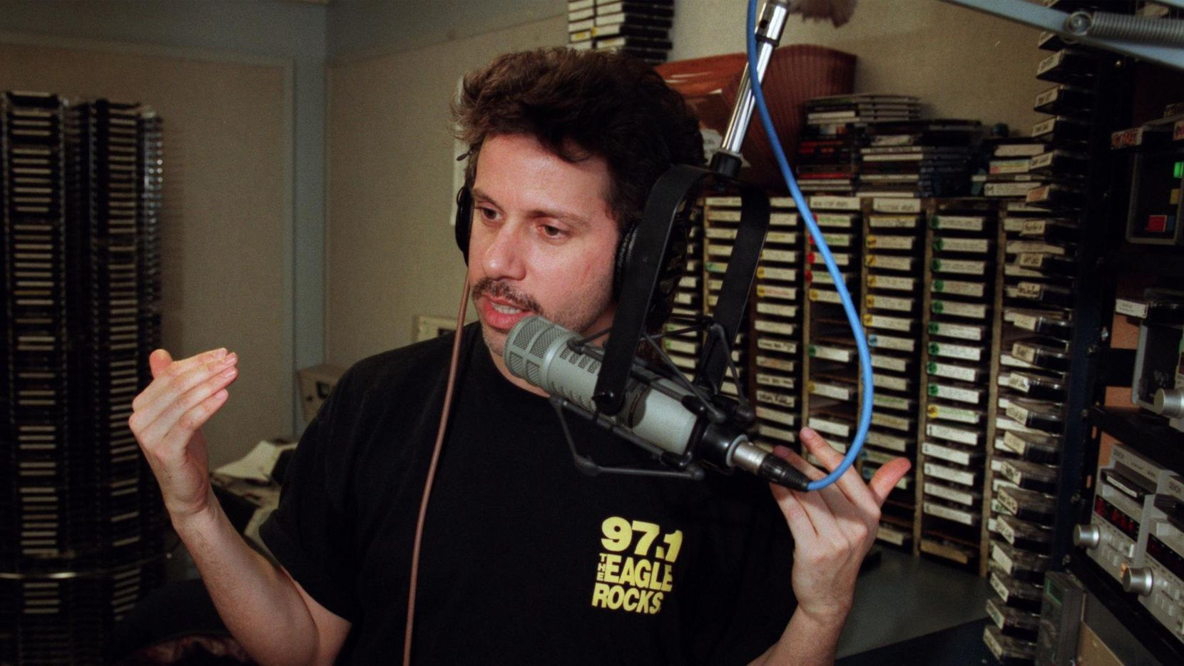 """Russ Martin pictured during his show on """"The Eagle"""" KEGL-FM (97.1) in a 2003 file photo."""