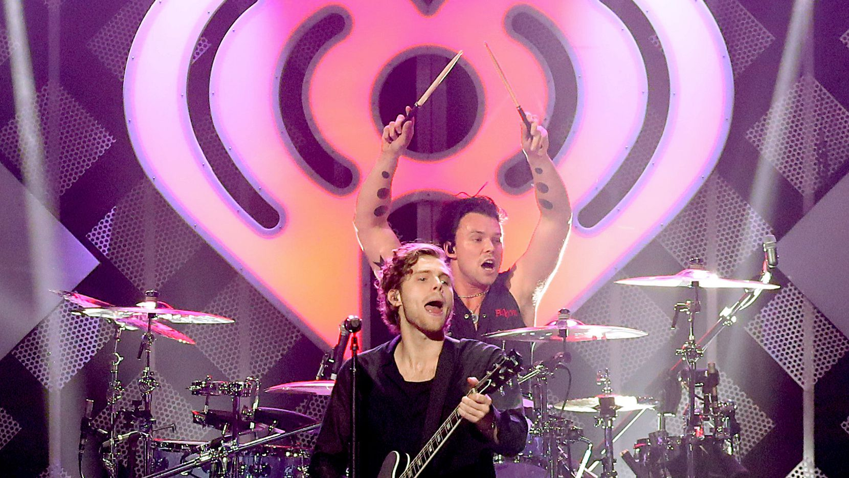 Ashton Irwin and Luke Hemmings of 5 Seconds of Summer performs onstage during KISS 108's iHeartRadio Jingle Ball 2019 on Dec. 15, 2019, in Boston, Mass.